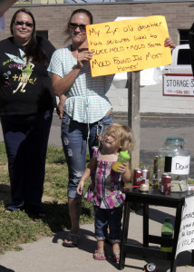 """Residents gather in protest of what they call """"slum lord"""" living conditions, Mammoth Mobile Estates, Cedar City, Utah, August 28, 2015   Photo by Carin Miller, St. George News"""