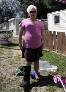 Dorothy Draper shows the boot she now wears as a result of negligence on behalf of the homeowners she said, Mammoth Mobile Estates, Cedar City, Utah, August 28, 2015   Photo by Carin Miller, St. George News