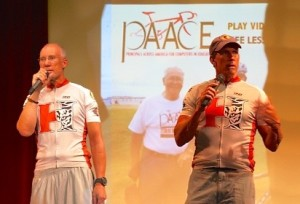 """L-R: Hurricane High School Principal Jody Rich, Hurricane Middle School Principal Roy Hoyt,  give address at welcome home event following their 3,000-mile bicycling journey across the U.S. with a puporse message, """"You can do hard things."""" Hurricane High School, Hurricane, Utah, July 23, 2013 