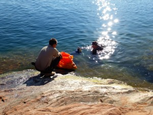 Volunteers from Dixie Divers help with cleanup of garbage under the water near the jumping rocks area of Sand Hollow Reservoir Saturday, Hurricane, Utah, Aug. 29, 2015 | Photo by Julie Applegate, St. George News