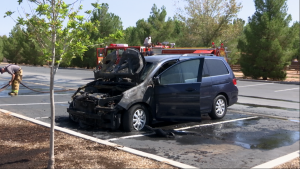 The smoldering remains of a Honda Odyssey sit in a parking lot after a mechanical issue resulted in a vehicle fire, Bloomington Park, St. George, Utah, Aug. 18, 2015 | Photo by Devan Chavez, St. George News