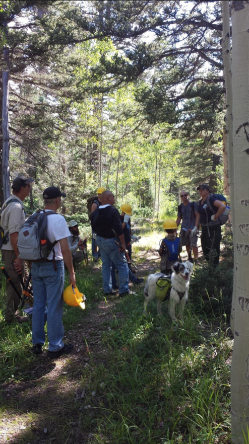 Wilderness and trails technician Denise Carpenter conducts a morning briefing with crews and volunteering veterans on the North Canyon trail, Kaibab National Forest, Aug. 22-25, 2015 | Photo courtesy of the U.S. Forest Service, St. George News