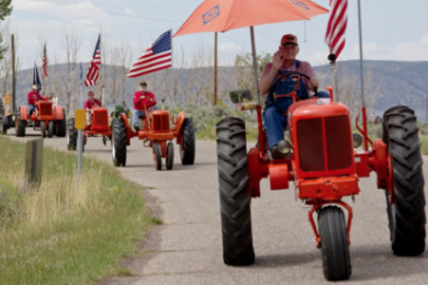 One of the annual highlights of the Iron County Fair is the vintage Tractor Caravan, shown in this photo from Aug. 31, 2013, when they traveled 28 miles and arrived in Parowan via the Parowan Gap. Every single one of them had a smile and a wave. Iron County Fair, Parowan, Utah, Aug. 31, 2013 | Photo by John Teas, St. George News