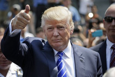 Donald Trump gives a thumbs-up as he leaves for lunch after being summoned for jury duty in New York, Monday, Aug. 17, 2015. Trump was due to report for jury duty Monday in Manhattan. The front-runner said last week before a rally in New Hampshire that he would willingly take a break from the campaign trail to answer the summons. | AP Photo by Seth Wenig, St. George News