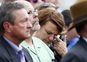 A woman who accompanied Tom Sullivan, who lost his son, Alex, in the massacre in an Aurora, Colo., theatre in July 21012, wipes tears outside the Arapahoe County Courthouse after a jury failed to agree on whether theater shooter James Holmes should get the death penalty, Centennial, Colo.,  Aug. 7, 2015 |  AP Photo by David Zalubowski, St. George News