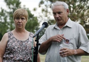 Robert and Sue Sullivan, whose 6-year-old granddaughter Veronica, whose picture is pinned to their chests, was killed in the theater shooting speak with the media outside Arapahoe County Courthouse after the jury failed to agree on whether James Holmes should get the death penalty, Centennial, Colo.,  Aug. 7, 2015 |  AP Photo by Brennan Linsey, St. George News