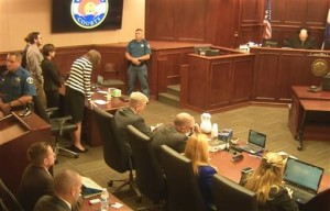 In this image made from Colorado Judicial Department video, Defense Attorney Tamara Brady, at left in stripped suit, leans into the defense table as Judge Carlos A. Samour, Jr., top right, reads the jury's sentencing verdict in the Colorado theater shooting trial in Centennial, Colo., Aug. 7, 2015 | Photo  courtesy of Colorado Judicial Department via AP, St. George News