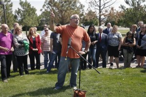 """Tom Sullivan, whose son Alex was killed in the 2012 Aurora movie theatre attack, backed by the families of those killed and wounded, speaks with members of the media after Colorado movie theater shooter James Holmes was formally sentenced, outside Arapahoe County District Court Holmes who unleashed a murderous attack on a packed Colorado movie theater was ordered Wednesday to serve life in prison without parole plus 3,318 years — the maximum allowed by law — before the judge told deputies, """"Get the defendant out of my courtroom, please."""" Centennial, Colo., Aug. 26, 2015   AP Photo by Brennan Linsley, St. George News"""