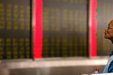 A Chinese investor monitors stock prices at a brokerage house in Beijing, Monday, Aug. 24, 2015. Stocks tumbled across Asia on Monday as investors shaken by the sell-off last week on Wall Street unloaded shares in practically every sector. Beijing, China, Aug. 24, 2015   AP Photo by Mark Schiefelbein; St. George News