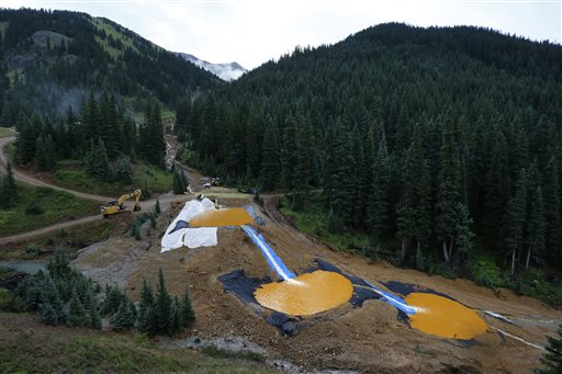 """In this Aug. 12, 2015 file photo, water flows through a series of retention ponds built to contain and filter out heavy metals and chemicals from the Gold King mine chemical accident, in the spillway about 1/4 mile downstream from the mine, outside Silverton, Colorado. Internal documents released by the U.S. Environmental Protection Agency on Friday, Aug. 21, show managers at the EPA were aware of the potential for a catastrophic """"blowout"""" at an abandoned mine that could release """"large volumes"""" of wastewater laced with toxic heavy metals. Silverton, Colorado, Aug. 12, 2015 