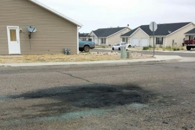 A charred spot is left on the road after an early morning vehicle fire in Cedar City, Utah, Aug. 1, 2015   Photo by David Juarez, St. George News