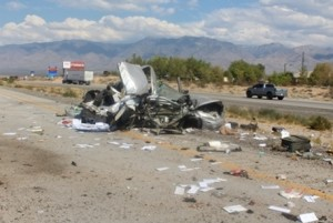 A collision near southbound Interstate 15 Arizona-Nevada state line left one man dead, a woman in critical condition and a semi engulfed in flames, Mesquite, Nevada, Aug. 9, 2015 | Photo courtesy of Nevada Highway Patrol, St. George News