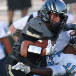 Desert Hills receiver Stetson Wood (2) puts a stiff arm on a Foothill defender, Desert Hills vs. Foothill Nev., Football, St. George, Utah, Aug. 28, 2015, | Photo by Robert Hoppie, ASPpix.com, St. George News