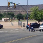 A bicyclist is injured after running a red light and being clipped by a car, St. George, Utah, Aug. 28, 2015 | Photo courtesy of Amy Palmer, St. George News