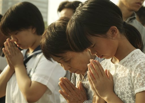 Japan marked the 70th anniversary of the atomic bombing on Hiroshima. Visitors pray for the atomic bomb victims in front of the cenotaph at the Hiroshima Peace Memorial Park in Hiroshima, western Japan, Aug. 6, 2015 | AP Photo by Koji Ueda, St. George News