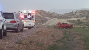 Police say the driver of the car was distracted by watching lightning, causing him to drift off the road and roll the car. The driver and passenger in the car – both juveniles – wearing wearing their seat belts and received only a few bumps and bruises, St. George Police Sgt. Dave Williams said, St. George, Utah, Aug. 14, 2015 | Photo by Mori Kessler, St. George News
