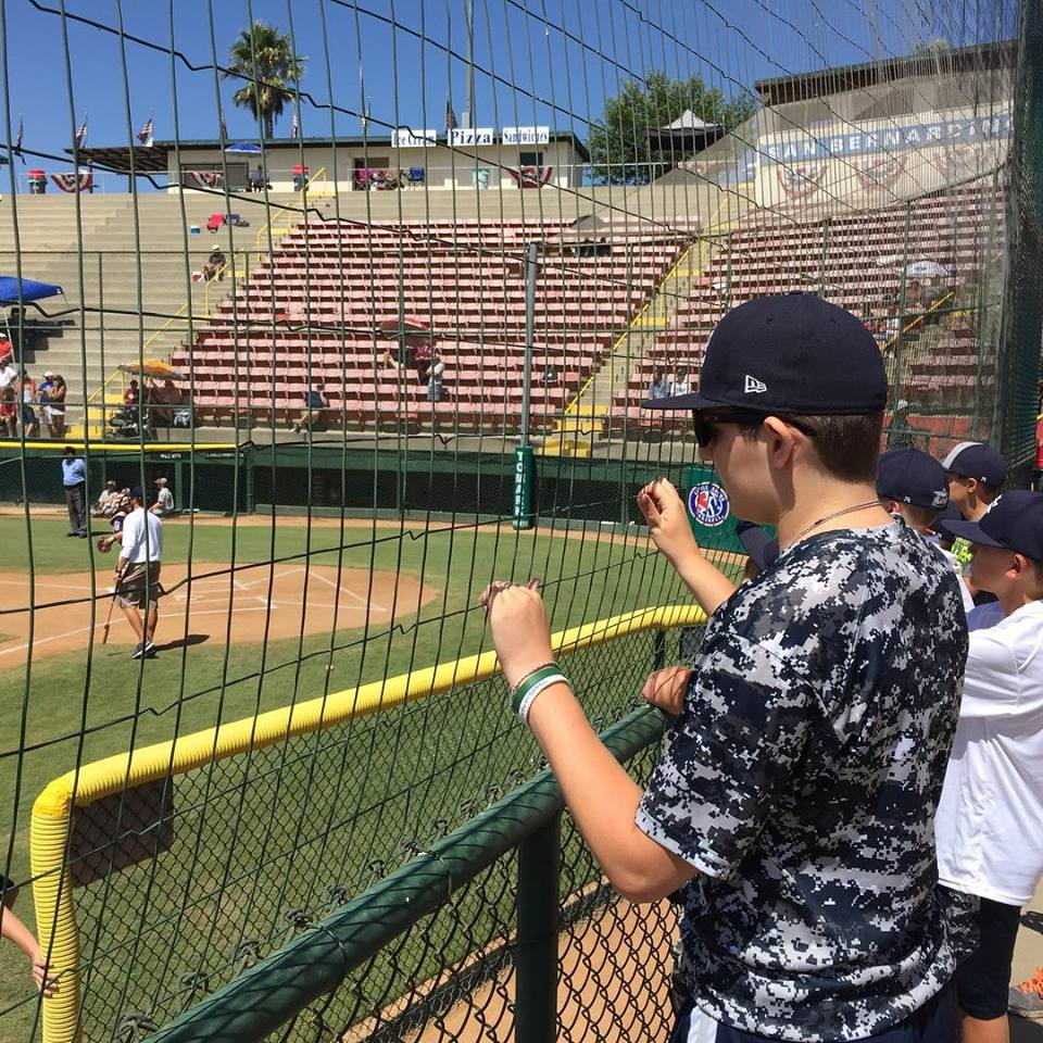Britton Shipp cheers on the Snow Canyon all-stars in the Little League West Regional San Bernardino, Calif., Monday afternoon.   Photo courtesy Jesse Shipp