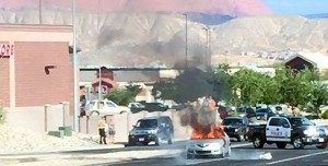 A Mazda 3 went up in flames while traveling on Green Springs Drive, Washington, Utah, Aug. 9, 2015 | Photo courtesy of Collette Williams, St. George News