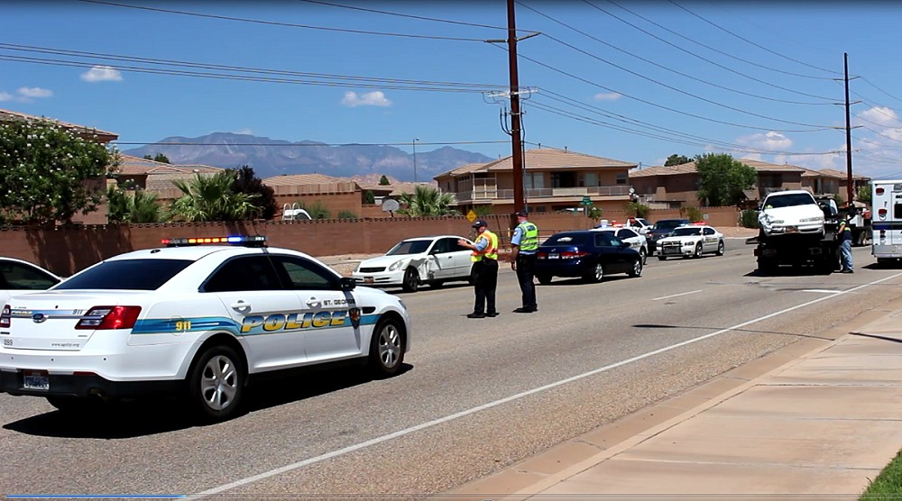 A two-car collision on River Road near 2450 East sent two people to the hospital with minor injuries, St. George, Utah, Aug. 10, 2015 | Photo by Mori Kessler, St. George News