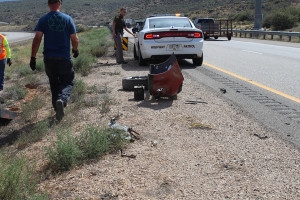 Items from a crashed  Hyundai lay in the road after the driver swerved to miss another vehicle and rolled the vehicle twice, Toquerville, Utah, August 13, 2015 | Photo by Nataly Burdick, St. George News