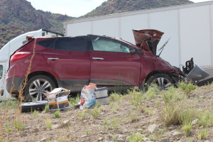 Damage to a Hyundai after the driver swerved to miss another vehicle and rolled the vehicle twice, Toquerville, Utah, August 13, 2015 | Photo by Nataly Burdick, St. George News