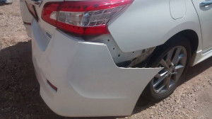 A Nissan was damaged after the car it was driving behind made a sudden u-turn, causing the cars behind it to slam their brakes, Washington, Utah, August 20, 2015   Photo by Nataly Burdick, St. George, Utah