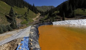 Water flows through a series of sediment retention ponds built to reduce heavy metal and chemical contaminants from the Gold King Mine wastewater accident, in the spillway about 1/4 mile downstream from the mine. Officials have said that federal contractors accidentally released more than 3 million gallons of wastewater laden with heavy metals last week at the Gold King Mine near Silverton. The pollution flowed downstream to New Mexico and Utah, Siverton, Colorado, Aug. 14, 2015 | AP Photo/Brennan Linsley, St. George News