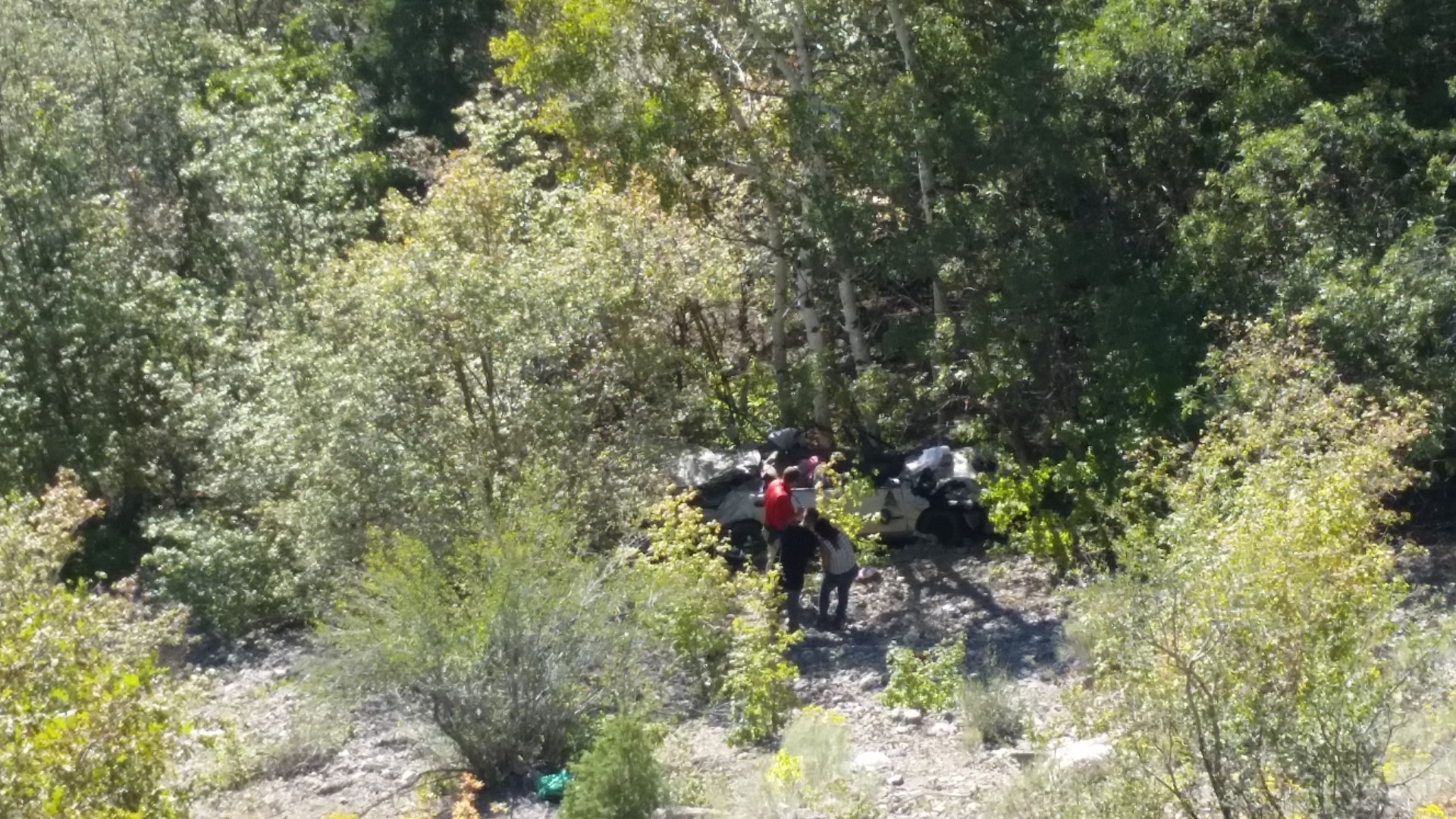Car that crashed several hundred feet down a mountainside in American Fork Canyon.  The driver, Heather Blackwelder, remained trapped inside for two days until two people out taking photographs heard her cries for help Thursday. American Fork Canyon, Utah, Sept. 10, 2015 | Photo courtesy of Utah County Sheriff's Office, St. George News