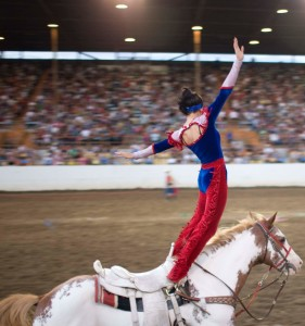 Trick rider stands on a horse, location and date unspecified | Photo courtesy of Cherry Creek Radio, St. George News
