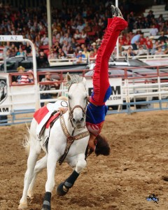Trick rider performs a dive while riding on a horse, location and date unspecified | Photo courtesy of Cherry Creek Radio, St. George News