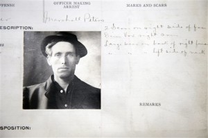 This photo from the Salt Lake City police department arrest record shows Joe Hill's entry. He was arrested on January 14, 1914. Lionized in a song sung by Pete Seeger and Bruce Springsteen, labor activist and songwriter Joe Hill is revered by many as a hero and martyr.  To others, Hill was a murderer who gunned down a Salt Lake City grocer and his son and got what he deserved when he was executed by firing squad in 1915 | AP Photo courtesy of the Utah state archives, The Salt Lake Tribune, St. George News