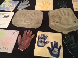 """""""Helping Hands."""" Hand prints that will create a mosaic to be displayed as part of the All Abilities Park on display at the """"Celebration of Abilities"""" variety show, St. George, Utah, Sept. 25, 2015   Photo by Hollie Reina, St. George News"""