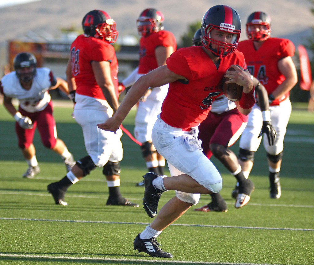 Dixie State quarterback Blake Barney (5) finds some open running room and scores a touchdown, Dixie State University vs. Central Washington University, St. George, Utah, Sept. 10, 2015, | Photo by Robert Hoppie, ASPpix.com, St. George News