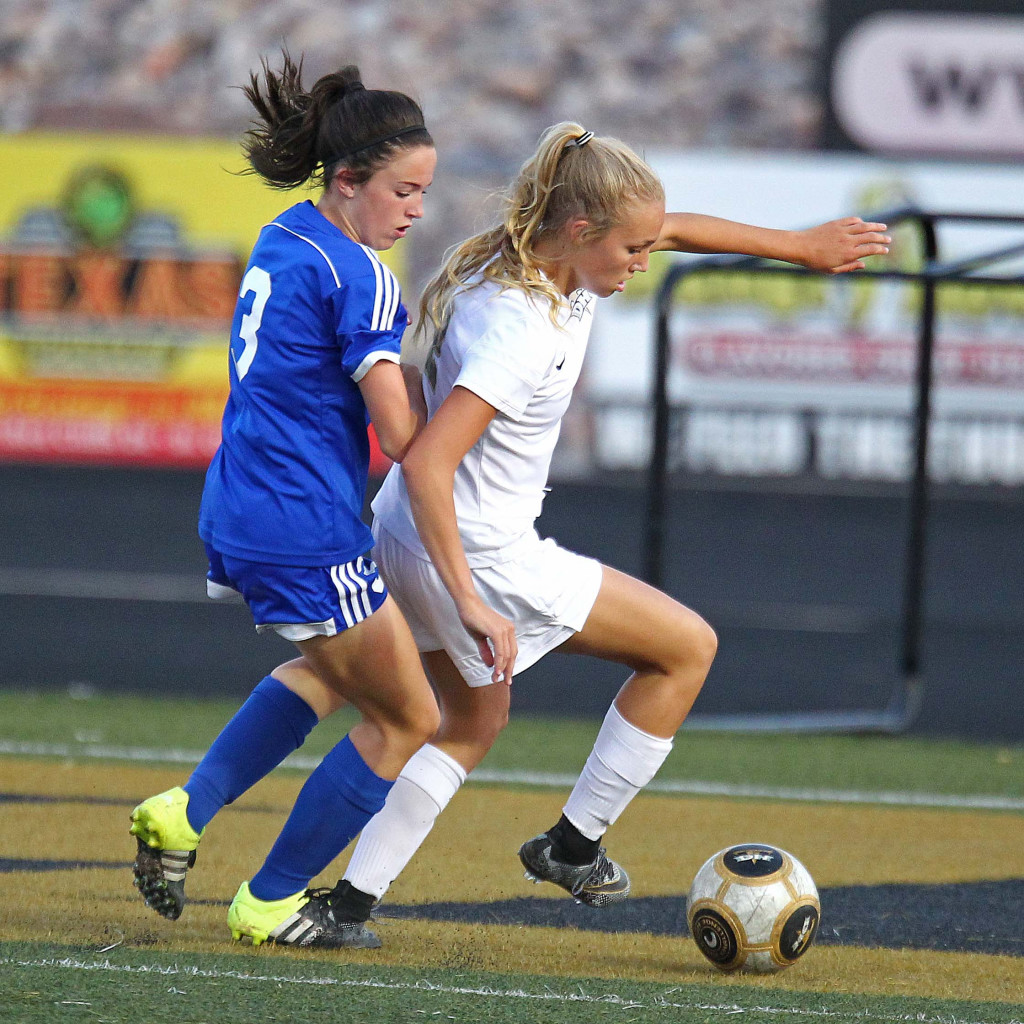 Lady Thunder striker Brook Lott controls the ball and heads for the goal with Dixie's Delaney Story (3) defending, Desert Hills vs. Dixie, Girls Soccer, St. George, Utah, Sept. 10, 2015, | Photo by Robert Hoppie, ASPpix.com, St. George News