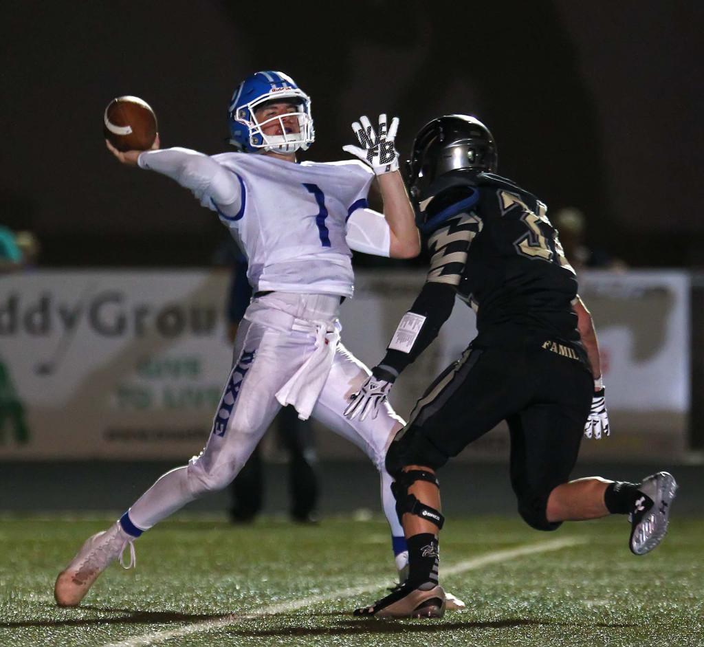 Zac Harrah (1) makes a deep throw for Dixie, Desert Hills vs. Dixie, Football, St. George, Utah, Sept. 25, 2015, | Photo by Robert Hoppie, ASPpix.com, St. George News