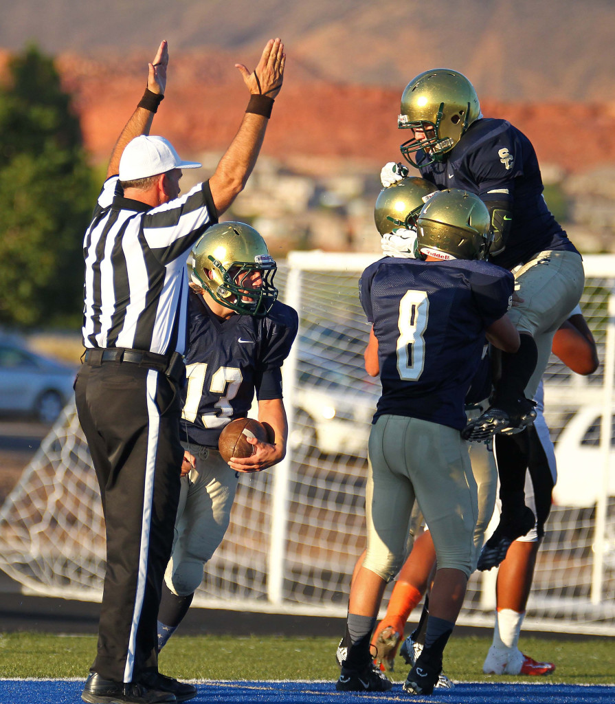Dylan Parry (13) recovers a blocked punt in the endzone for a Warrior touchdown, Snow Canyon vs. Ogden, Football, St. George, Utah, Sept. 11, 2015,   Photo by Robert Hoppie, ASPpix.com, St. George News