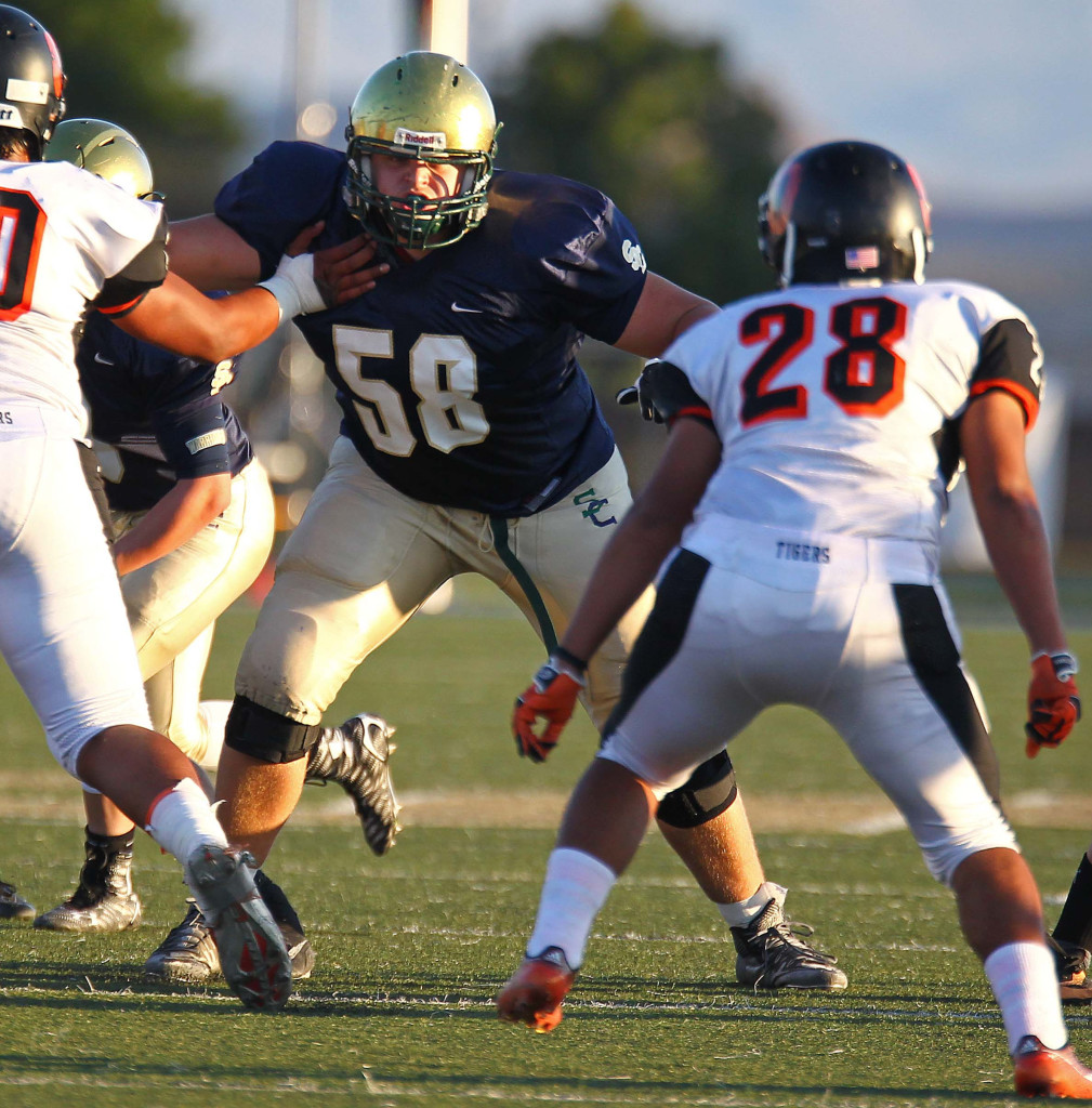 Blake Gubler (58) on the line for Snow Canyon, Snow Canyon vs. Ogden, Football, St. George, Utah, Sept. 11, 2015, | Photo by Robert Hoppie, ASPpix.com, St. George News