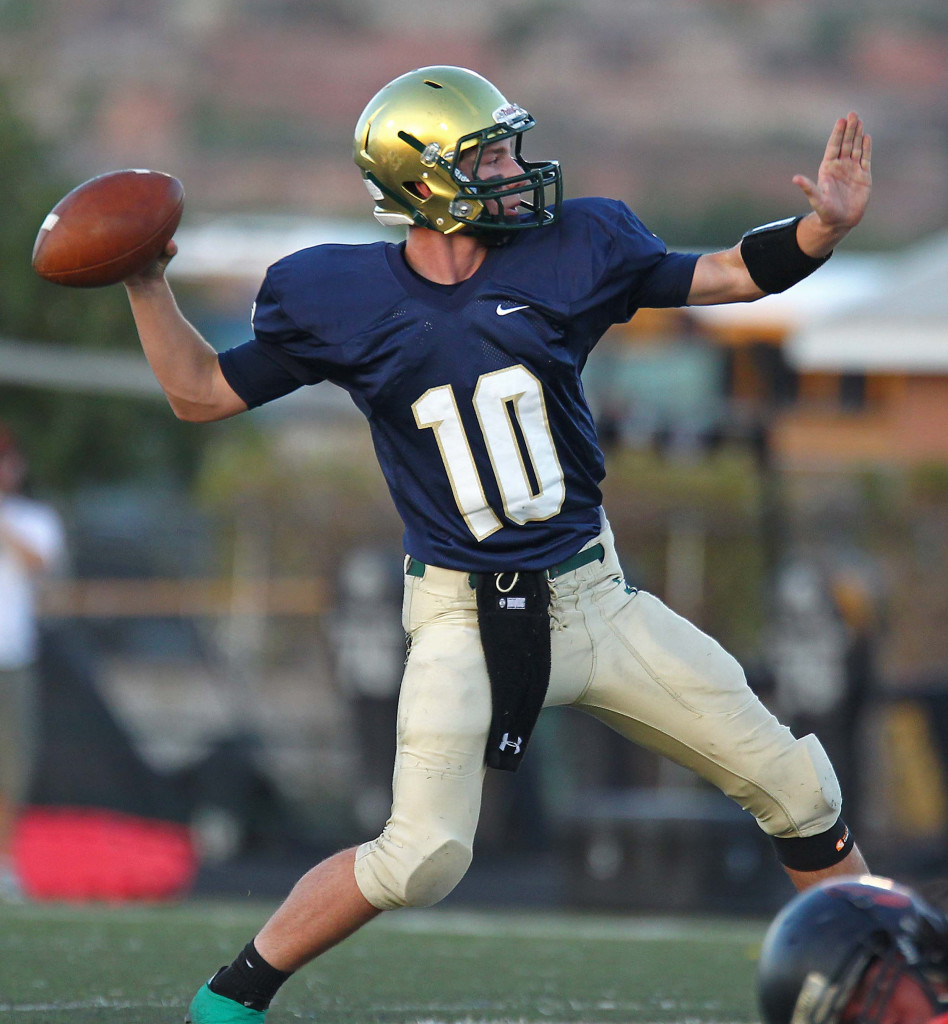 Warrior quarterback Jackson Nowatzke (10) fires a pass, Snow Canyon vs. Ogden, Football, St. George, Utah, Sept. 11, 2015, | Photo by Robert Hoppie, ASPpix.com, St. George News