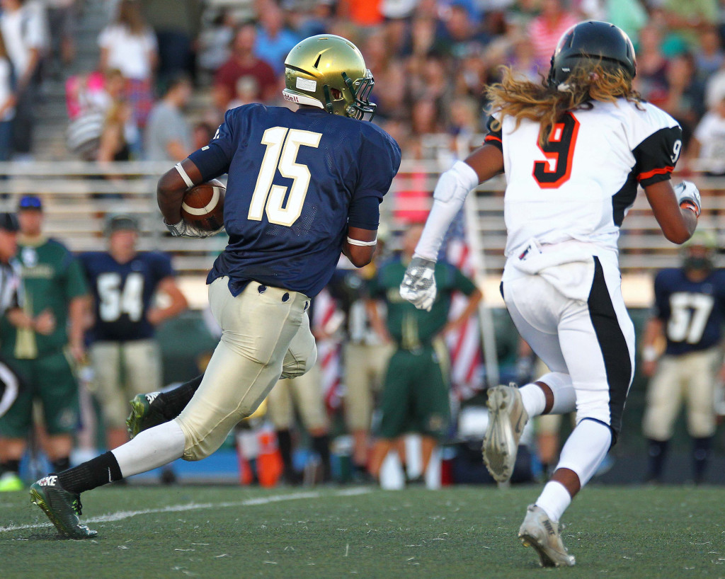 Snow Canyon receiver Tj Taimi (15) gets some yards after a catch, Snow Canyon vs. Ogden, Football, St. George, Utah, Sept. 11, 2015, | Photo by Robert Hoppie, ASPpix.com, St. George News
