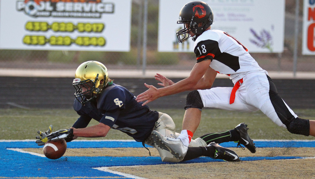 Snow Canyon running back Chris Poulsen dives on his own fumble to score a touchdown, Snow Canyon vs. Ogden, Football, St. George, Utah, Sept. 11, 2015, | Photo by Robert Hoppie, ASPpix.com, St. George News