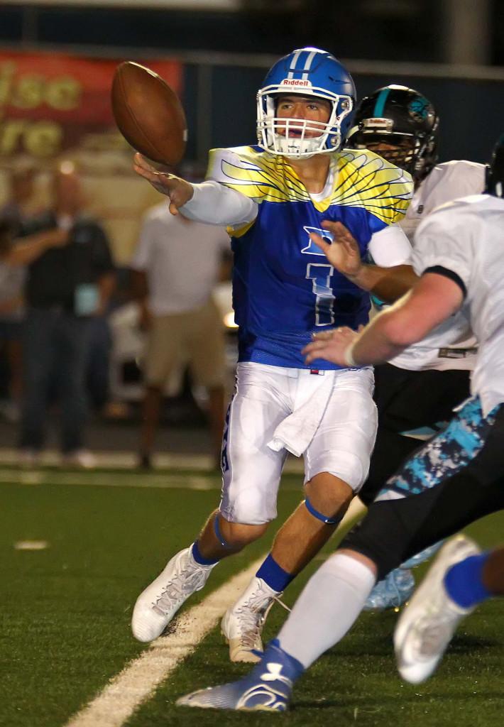 Dixie quarterback Zac Harrah (1) makes a pitch, Dixie vs. Canyon View, Football, St. George, Utah, Sept. 11, 2015, | Photo by Robert Hoppie, ASPpix.com, St. George News