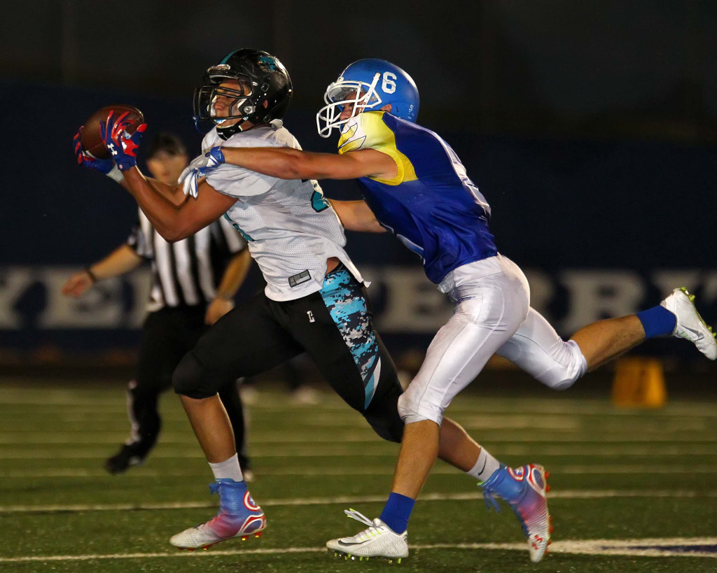Canyon View's Xavier Stoker makes a catch in front of Dixie defender Jaden Harrison (6), Dixie vs. Canyon View, Football, St. George, Utah, Sept. 11, 2015, | Photo by Robert Hoppie, ASPpix.com, St. George News