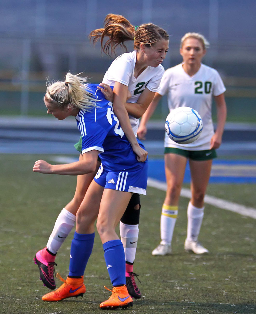 Snow Canyon's Sarah Evans (22) and Dixie's Kennedy Warnick (23) battle for a loose ball, Snow Canyon vs. Dixie, Girls Soccer, St. George, Utah, Sept. 15, 2015, | Photo by Robert Hoppie, ASPpix.com, St. George News