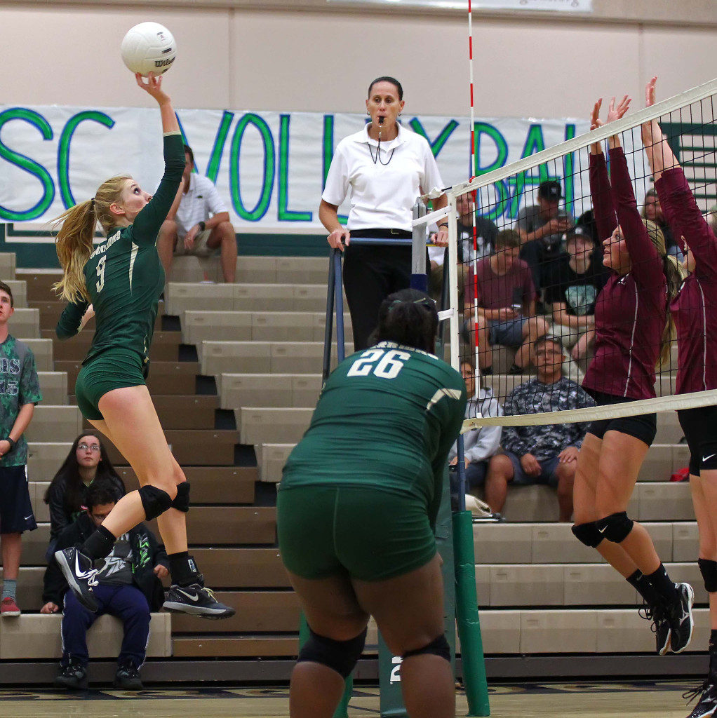 Nikenna Durante tips a ball over the net for Snow Canyon, Snow Canyon vs. Pine View, Volleyball, St. George, Utah, Sept. 15, 2015, | Photo by Robert Hoppie, ASPpix.com, St. George News