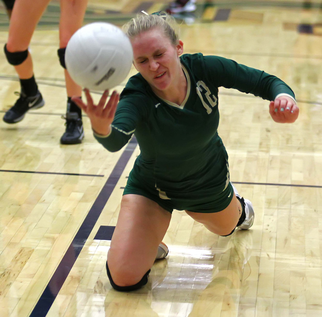Shaylee Reed (12) dives for a ball for the Lady Warriors, Snow Canyon vs. Hurricane, Volleyball, St. George, Utah, Sept. 29, 2015,   Photo by Robert Hoppie, ASPpix.com, St. George News