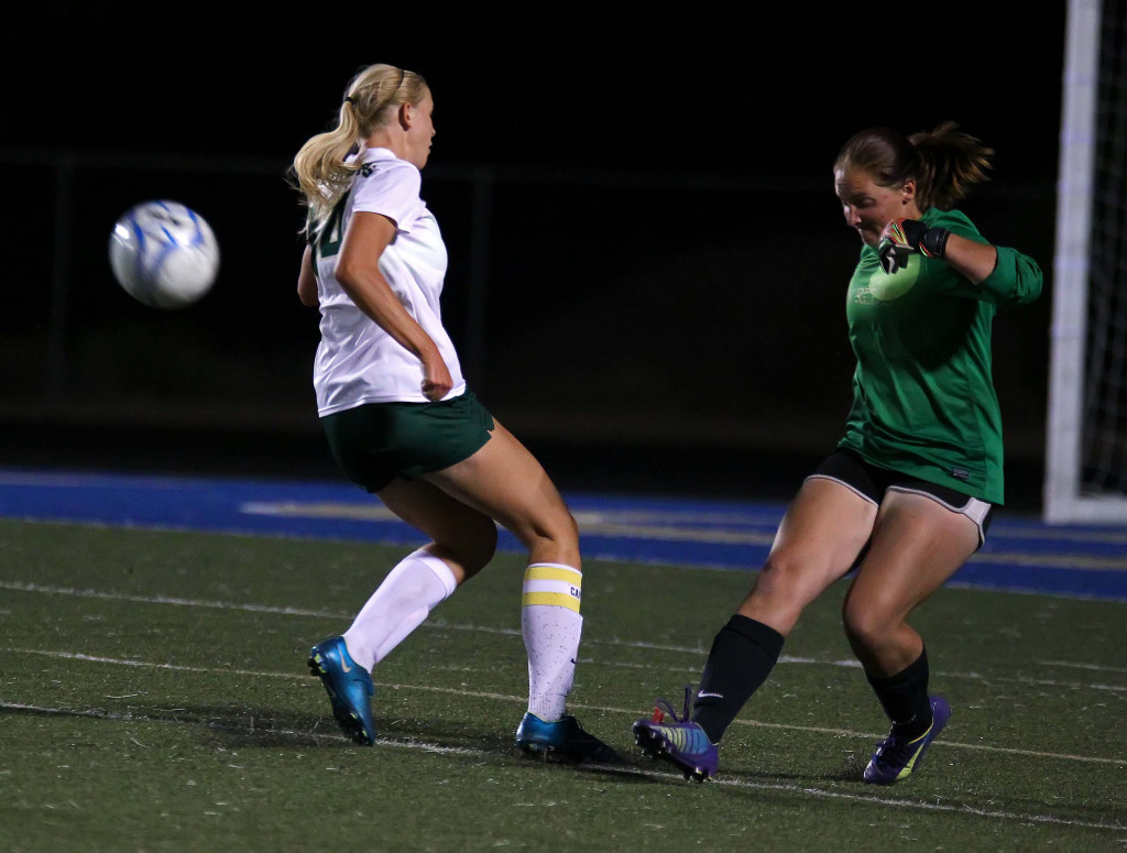 Snow Canyon's Jenny Stewart and Cedar goalkeeper Megan Giddings, Snow Canyon vs. Cedar, Girls Soccer, St. George, Utah, Sept. 29, 2015, | Photo by Robert Hoppie, ASPpix.com, St. George News