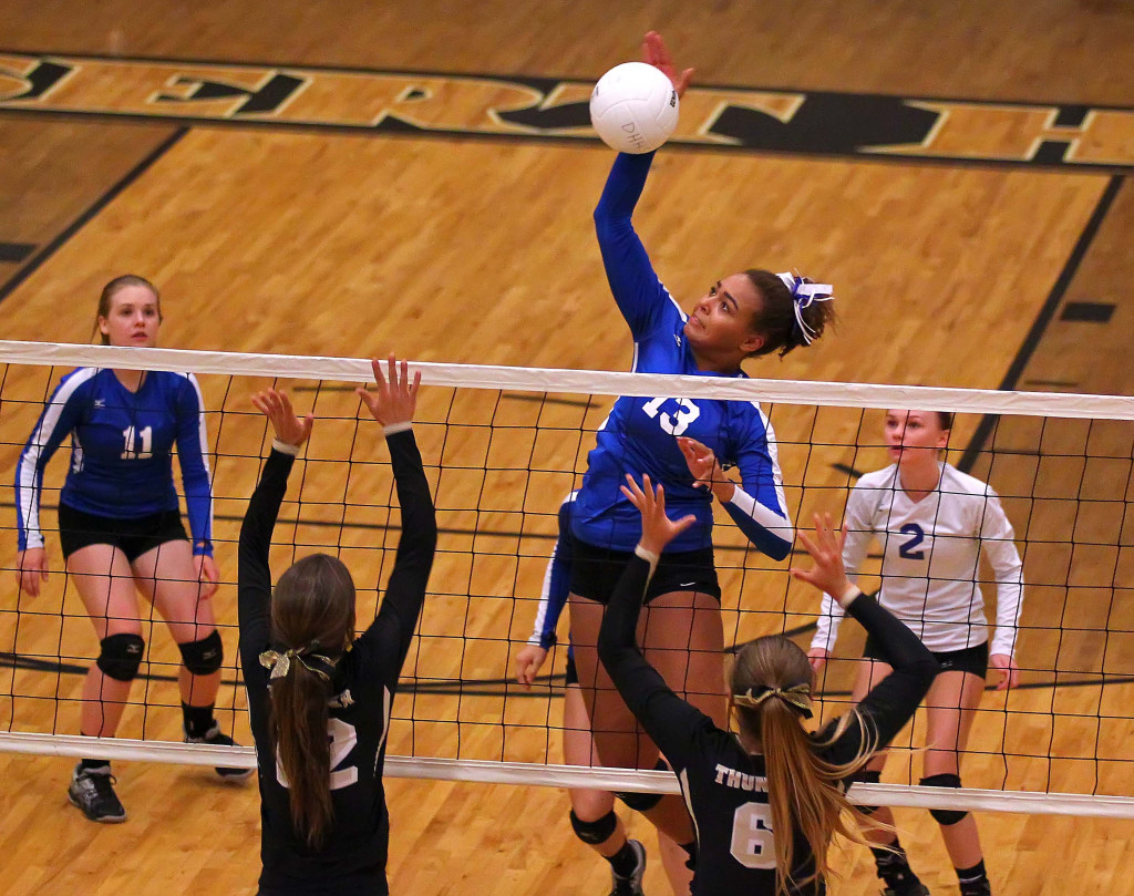 DeAubrey Bowers (13 with a spike for Dixie, Desert Hills vs. Dixie, Volleyball, St. George, Utah, Sept. 17, 2015, | Photo by Robert Hoppie, ASPpix.com, St. George News