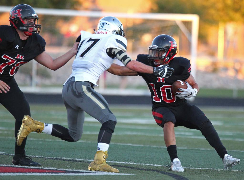 Kyler Terry (17) makes a tackle for the Thunder, Hurricane vs. Desert Hills, Football, Hurricane, Utah, Sept. 18, 2015, | Photo by Robert Hoppie, ASPpix.com, St. George News