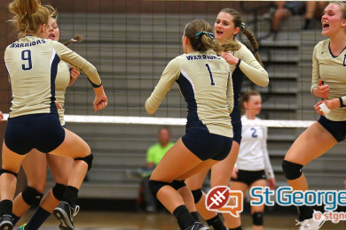 The Snow Canyon Warriors celebrate their victory over Dixie, Dixie vs. Snow Canyon, Volleyball, St. George, Utah, Sept. 21, 2015, | Photo by Robert Hoppie, ASPpix.com, St. George News