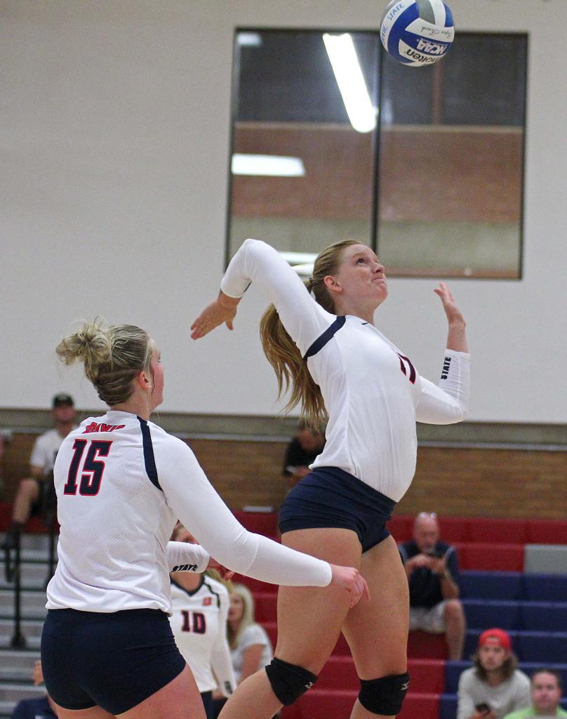Dixie State's Mackenzi Bird-Murphey leaps to spike a ball, Dixie State University Volleyball, St. George, Utah, Sept. 4, 2015, | Photo by Robert Hoppie, ASPpix.com, St. George News
